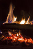 Flames in the fireplace. Wood is burning in the fireplace Stock Photos