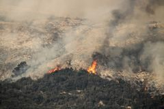 Flames Flare Up On California Mountainside Above Carpinteria Royalty Free Stock Photography