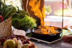 Flames in frying pan. Stock Images