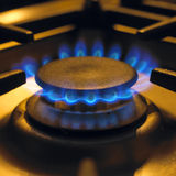 Flames on gas cooker hob. Blue flames burning on gas cooker hob Stock Photos
