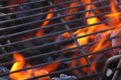 Flames in the grill. Just lighting the barbecue and the flames are coming up through the grill Stock Image