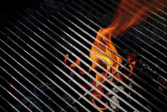 Flames on the Grill. Flames shooting through the grill of a charcoal barbeque Stock Photography