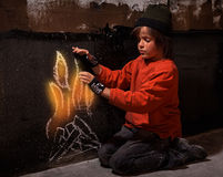 Flames of hope - homeless boy warming Royalty Free Stock Images