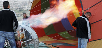 Flames hot air balloon roadies getting ready Royalty Free Stock Photography