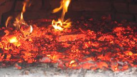 Flames and hot coals in the oven stock footage