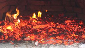 Flames and hot coals in the oven stock video footage