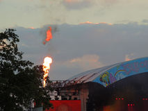 Flames at the Isle of Wight Festival. Flames form part of the light show on the Main Stage at the Isle of Wight Festival in June 2014 Royalty Free Stock Photo