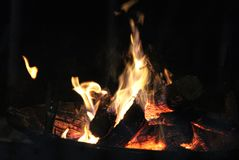 Flames. Leap into the air when combustion takes place.  This is a typical open fire used to warm surroundings outside when the weather is cold, and when Stock Image