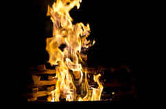 Flames lit the fire, warming his warmth in cold weather. Rules of safe breeding of fire. Stock Photos