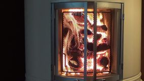 Flames in livingroom fireplace - parallel closeup stock footage