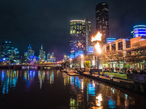 Flames at Melbourne`s Crown Casino. Flames shoot out from the towers at Melbourne`s Crown Casino while crowds stroll along the river Stock Photos