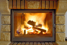 Flames in a modern fireplace Royalty Free Stock Photos