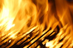 Flames Over Grill. A photo of some flames over a grill Stock Photos