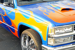 Flames painted on a custom truck. Image of a custom painted truck Stock Photography