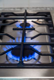 Flames in Stainless Steel Cooktop Royalty Free Stock Image