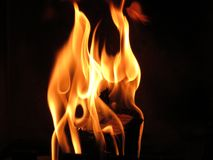 Flames. Wood burning in  flames in a fireplace Stock Photos