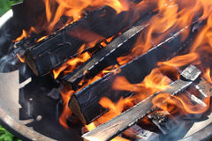 Flames on wood in grill Royalty Free Stock Photography