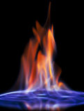 Flaming alcohol black background Royalty Free Stock Photography