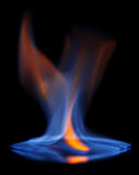 Flaming alcohol black background Royalty Free Stock Photos