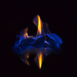 Flaming alcohol black background Royalty Free Stock Image