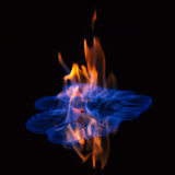 Flaming alcohol black background Stock Images