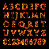 Flaming Alphabet and Numbers. A set of fiery flaming letters and numbers isolated over black Stock Photo