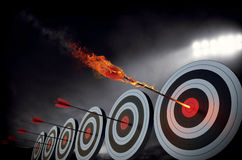 Flaming arrow. Hitting the center of target Stock Image