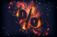 Flaming ashes surrounding a percentage sign Stock Image