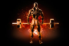 Flaming athlete with a barbell. View from the back Stock Photo