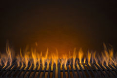 Flaming Barbecue Grill Background. Flaming Hot Barbecue Grill and a Glowing Amber Background Stock Photo