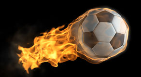 Flaming baseball. A Soccer ball thats on fire flying through the air Stock Image