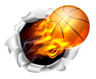 Flaming Basketball Ball Tearing a Hole in the Background Stock Photo