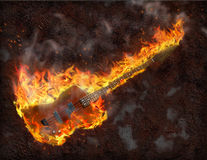 Flaming Bass Guitar. Against rusted metal background Royalty Free Stock Images