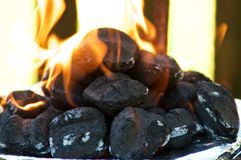Flaming BBQ briquettes at eye level royalty free stock photography