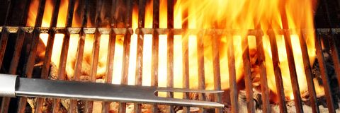 Flaming BBQ Grill. BBQ Tool Fire Flames Grill Spatula Fork Royalty Free Stock Photography