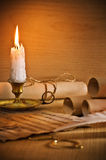 Flaming candle and antic musical notes Stock Images