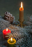 Flaming candles with Christmas twig Royalty Free Stock Photos