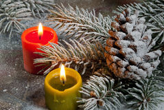 Flaming candles with Christmas twig Royalty Free Stock Images