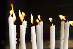 Flaming Candles for Prayer Stock Image