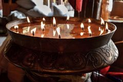 Flaming candles. Spiritual image of monastic candles providing sacred light. Spiritual image of monastic candles providing sacred light Stock Photography