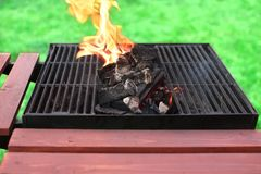Flaming charcoal and BBBQ Grill Stock Image