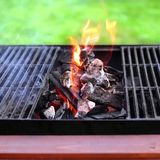 Flaming charcoal and BBBQ Grill Royalty Free Stock Photos