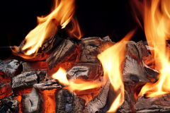 Flaming Charcoal  On Black Background Royalty Free Stock Photo