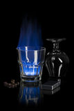 Flaming cocktail. The flaming sambuca over black Royalty Free Stock Images
