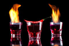 Flaming cocktail of red pepper Royalty Free Stock Photo