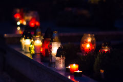 Flaming colored candle on the grave Royalty Free Stock Photo