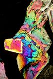 Flaming Crystals. Crystals under the Microscope, 100fold in polarised light. Each layer of the mixed crystals shines in different colors of the spectrum Stock Photos