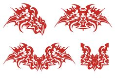 Flaming dragon head symbols. Red and white tribal dragon symbols in the fire form Royalty Free Stock Photo