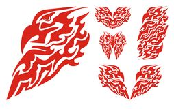 Flaming eagle head and tribal eagle elements. Set of the flaming eagle symbols in the form of fire Stock Images