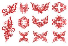 Flaming eagle symbols in tribal style Royalty Free Stock Photos